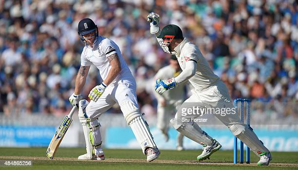 England batsman Ben Stokes looks on as keeper Peter Nevil celebrates his dismissal during day three of the 5th Investec Ashes Test match between...