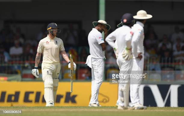England batsman Ben Stokes makes his way back to the wicket after as he is called back for a second time reprieved after the ball is given as a no...