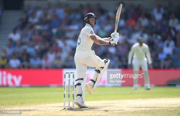 England batsman Ben Stokes pulls a ball from Cummins for 6 runs during day four of the 3rd Ashes Test Match between England and Australia at...