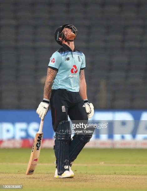 England batsman Ben Stokes reacts after being dismissed for 99 runs during the 2nd One Day International between India and England at MCA Stadium on...
