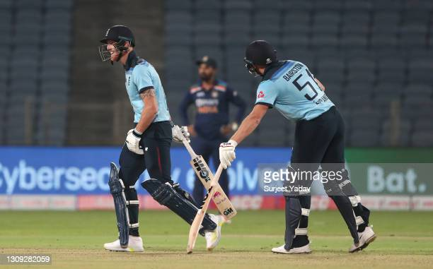 England batsman Ben Stokes shares a joke with Jonathan Bairstow after hitting a six during the 2nd One Day International between India and England at...