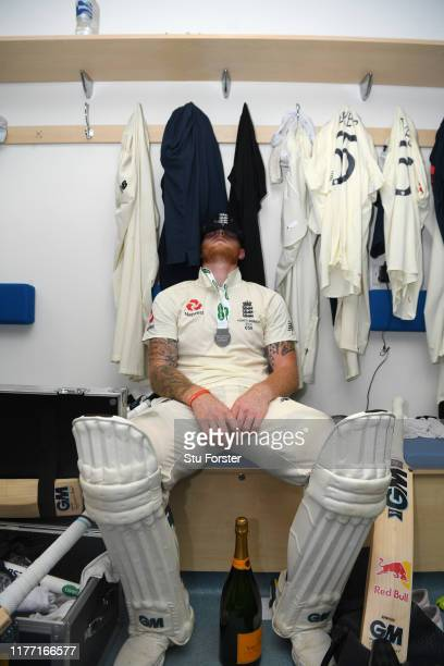 England batsman Ben Stokes takes a moment to reflect in the dressing room after hitting 135 not out to win the match for England by 1 wicket after...