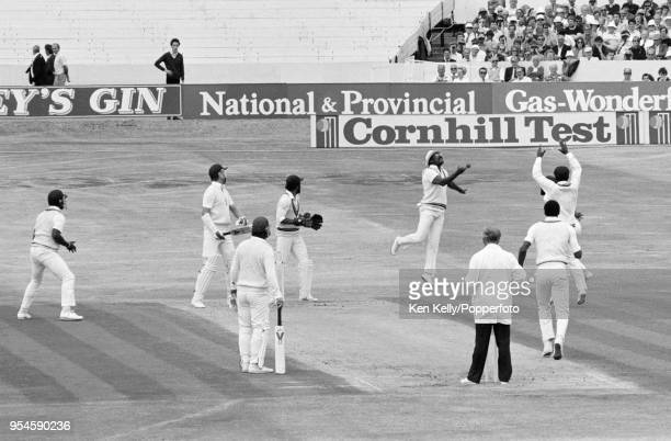 England batsman Chris Broad is caught at slip for 32 runs by Clive Lloyd of West Indies off the bowling of Roger Harper during the 3rd Test match...