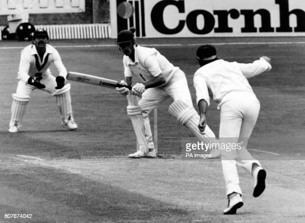 England batsman Chris Tavare ducks to a bouncer from Australian bowler Dennis Lillee as Australian wicketkeeper Rod Marsh anticipates a catch