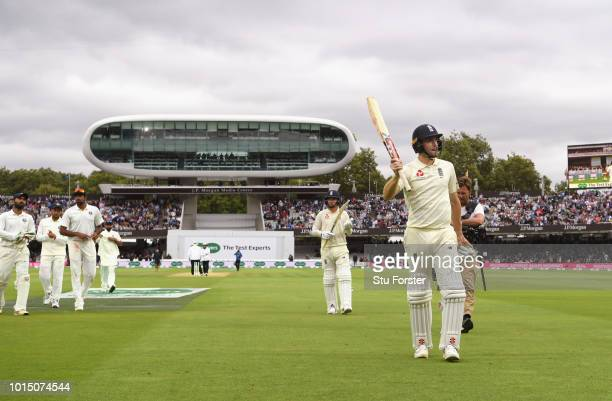 England batsman Chris Woakes acknowledges the applause from the crowd as the players leave the field due to bad light during Day 3 of the 2nd Test...