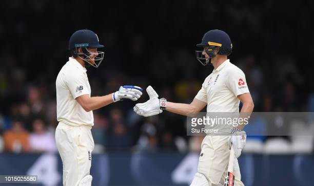 England batsman Chris Woakes reaches his 50 and is congratulated by Jonny Bairstow during Day 3 of the 2nd Test Match between England and India at...