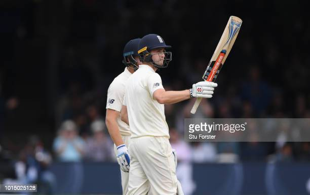 England batsman Chris Woakes reaches his 50 during Day 3 of the 2nd Test Match between England and India at Lord's Cricket Ground on August 11 2018...