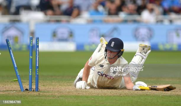 England batsman Dan Lawrence reacts after diving to make his ground during day four of the First Test Match between England nd India at Trent Bridge...