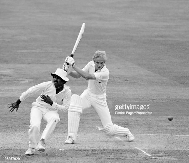 England batsman David Gower drives the ball, causing Javed Miandad of Pakistan, fielding at silly point, to take evasive action during the 2nd Test...