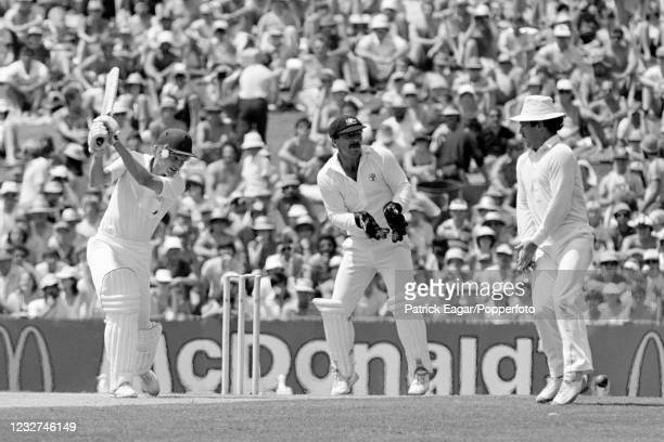 England batsman David Gower drives the ball past Allan Border of Australia during his innings of 70 runs in the 5th Test match between Australia and...