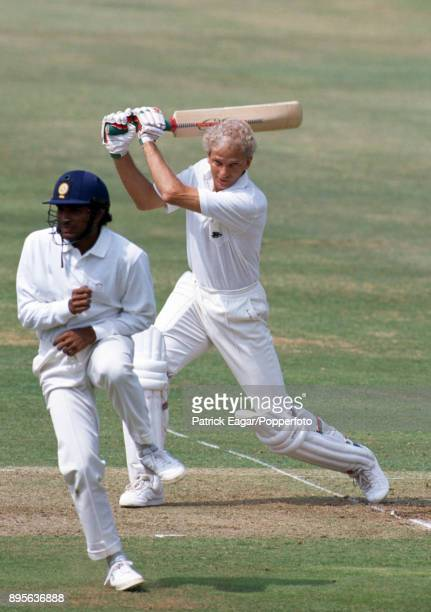 England batsman David Gower drives the ball past Indian fielder Sanjay Manjrekar during the 1st Test match between England and India at Lord's...