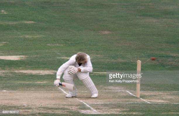 England batsman David Gower ducks a bouncer from New Zealand bowler Richard Hadlee that narrowly misses the stumps during the 3rd Test match between...