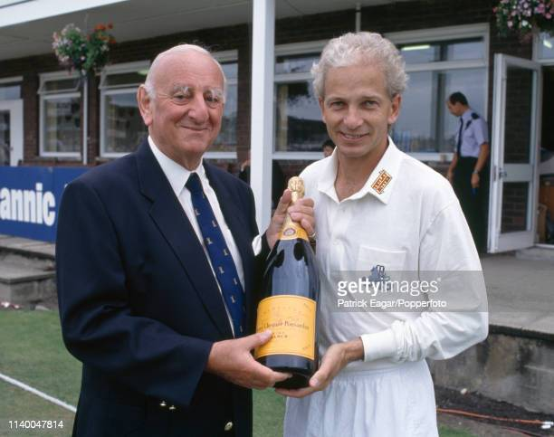 England batsman David Gower is presented with a bottle of champagne by BBC Test Match Special commentator Brian Johnston during the 4th Test match...