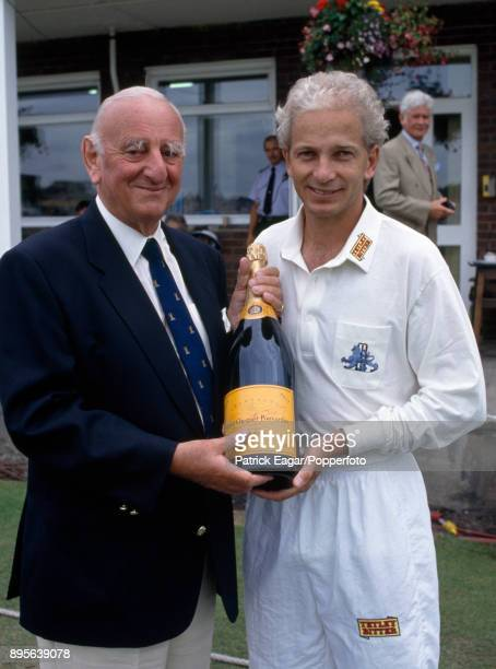 England batsman David Gower is presented with a bottle of champagne by Test Match Special commentator Brian Johnston during the 4th Test match...