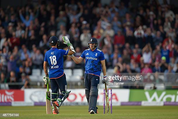 England batsman David Willey celebrates with Moeen Ali after hitting a six to win the match during the 4th Royal London OneDay International match...