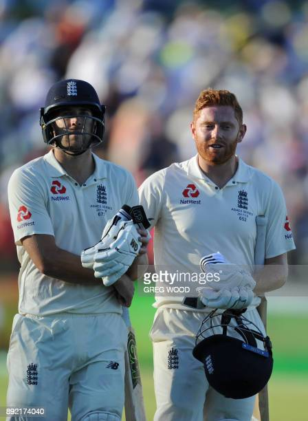 England batsman Dawid Malan and Jonny Bairstow leave the field at the end of day one of the third Ashes cricket Test match against Australia in Perth...