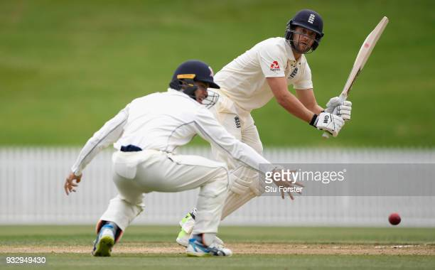 England batsman Dawid Malan hits out past fielder Mark Chapman during day two of the Test warm up match between England and New Zealand Cricket XI at...