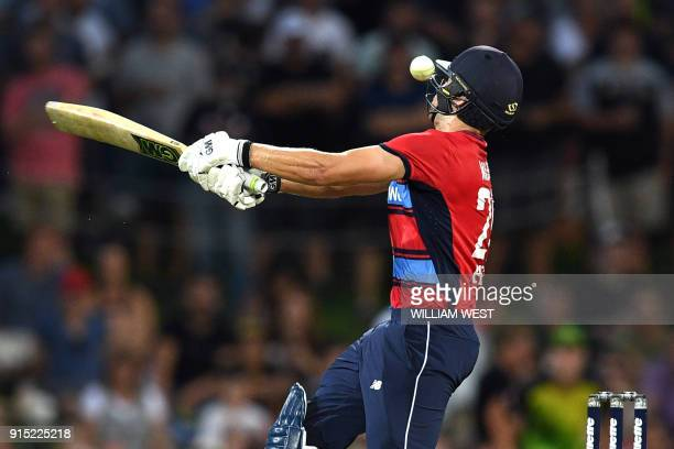 England batsman Dawid Malan is struck on the helmet by a delivery from Australia's Andrew Tye during their Twenty20 cricket match at Bellerive Oval...