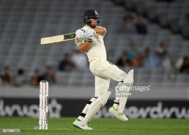 England batsman Dawid Malan pulls a ball to the boundary during day four of the First Test Match between the New Zealand Black Caps and England at...