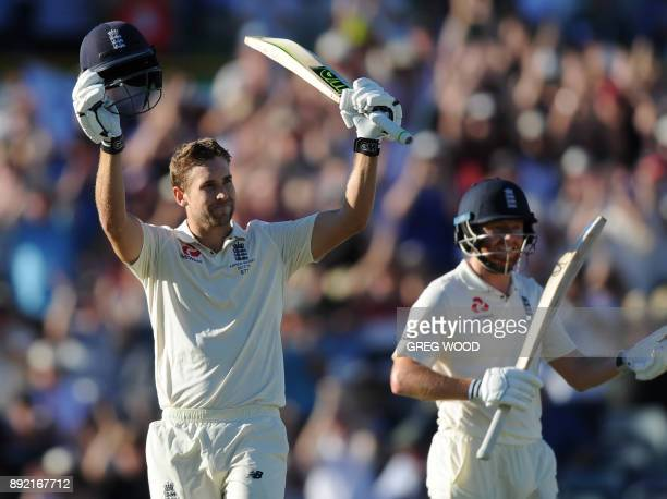 England batsman Dawid Malan raises his bat after scoring a century on day one of the third Ashes cricket Test match against Australia in Perth on...