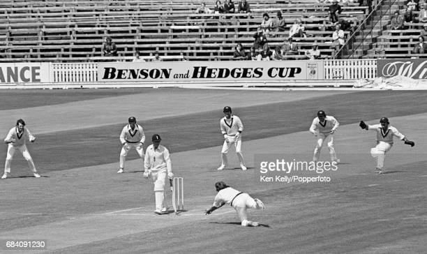 England batsman Dennis Amiss is caught by Australian substitute fielder Gary Gilmour for 5 runs in the 1st Test match between England and Australia...