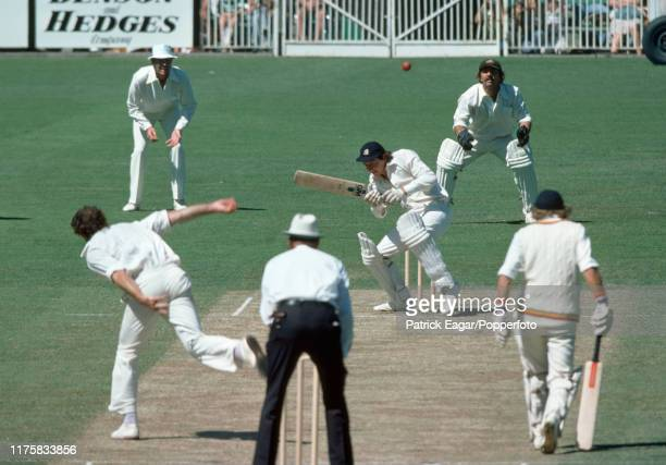 England batsman Derek Randall ducks a bouncer from Dennis Lillee of Australia during the Centenary Test match between Australia and England at the...