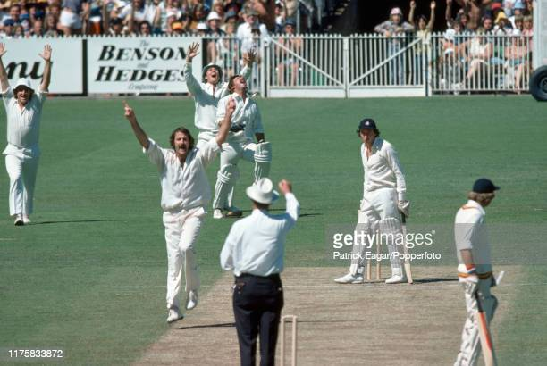 England batsman Derek Randall is caught behind for 4 runs by Rodney Marsh of Australia off the bowling of Dennis Lillee during the Centenary Test...