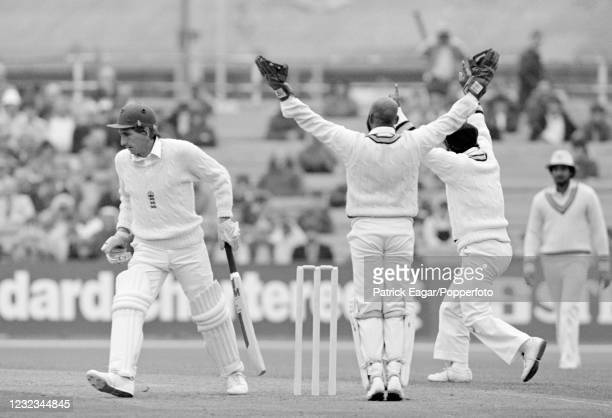 England batsman Derek Randall is caught for 0 between the legs of India's wicketkeeper Syed Kirmani off the bowling of Dilip Doshi during the 2nd...