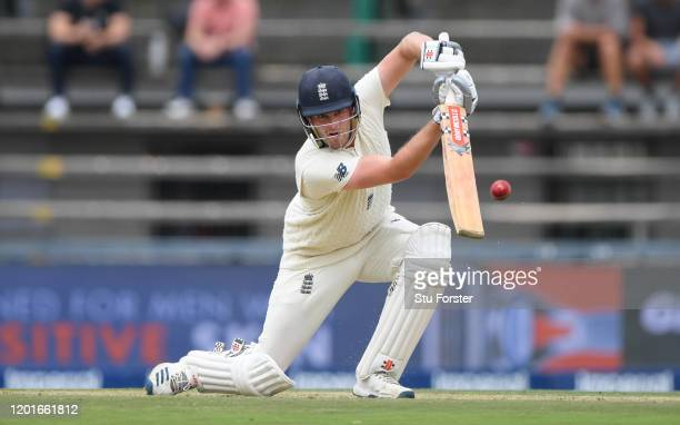 England batsman Dom Sibley drives towards the boundary during Day One of the Fourth Test between South Africa and England at The Wanderers on January...