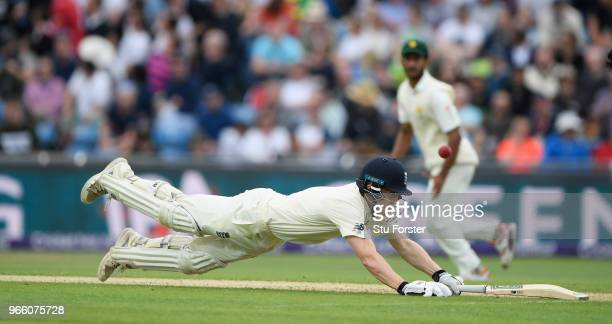 England batsman Dominic Bess dives to make his ground during day two of the second test match between England and Pakistan at Headingley on June 2...