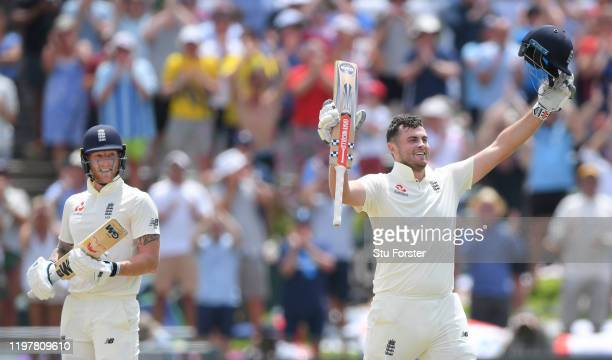England batsman Dominic Sibley celebrates after reaching his maiden Test century as Ben Stokes looks on during Day Four of the Second Test between...