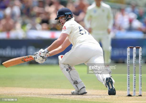 England batsman Dominic Sibley sweeps for the single to reach his maiden Test century during Day Four of the Second Test between South Africa and...