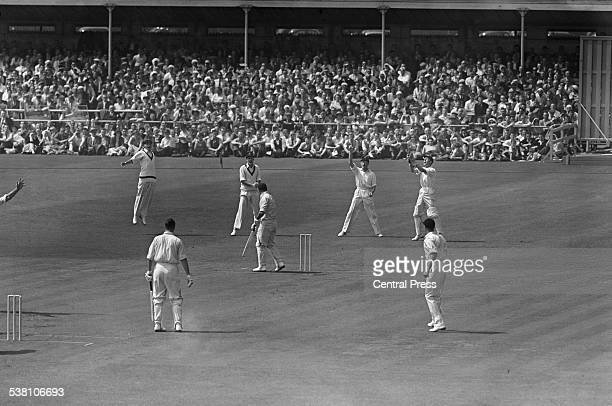England batsman Don Kenyon after being caught out by South African wicket keeper John Waite on the fourth day of the third Test at Old Trafford...