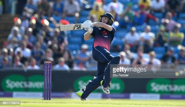 England batsman Eoin Morgan brings up his hundred with a pull shot to the boundary during the 1st Royal London One Day International match between...