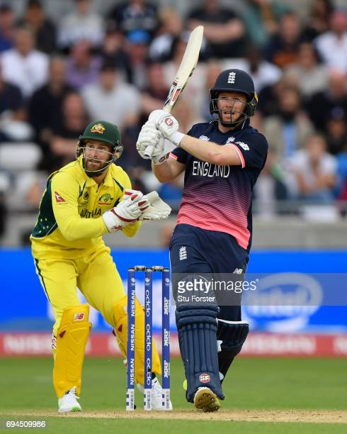 England batsman Eoin Morgan hits a six watched by Matthew Wade during the ICC Champions Trophy match between England and Australia at Edgbaston on...