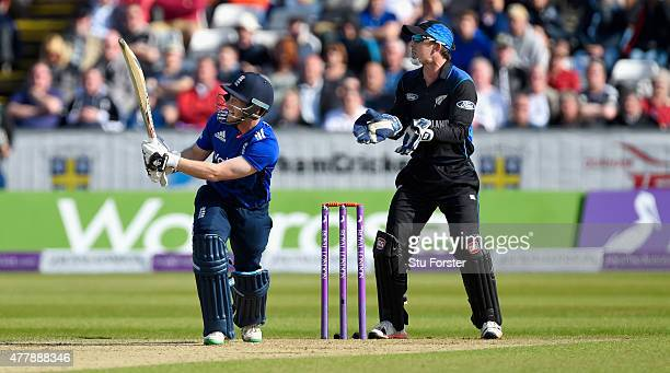 England batsman Eoin Morgan hits out only to be caught as wicketkeeper Luke Ronchi looks on during the 5th Royal London One day international between...