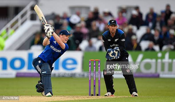 England batsman Eoin Morgan hits out watched by Luke Ronchi during the 4th ODI Royal London One Day International between England and New Zealand at...