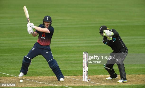 England batsman Eoin Morgan hits out watched by Tom Latham during the 3rd ODI between New Zealand and England at Westpac stadium on March 3 2018 in...