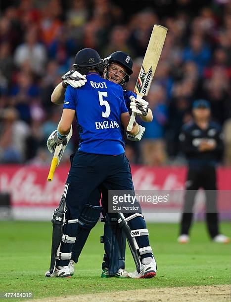 England batsman Eoin Morgan is congratulated on his century by partner Joe Root during the 4th ODI Royal London One Day International between England...