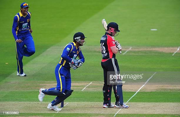 England batsman Eoin Morgan looks on as wicketkeeper Kumar Sangakkara celebrates his wicket during the 3rd Natwest One Day International Series match...