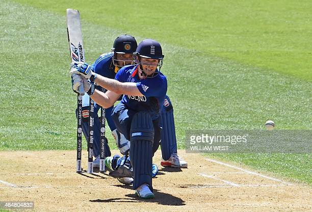 England batsman Eoin Morgan prepares to play a reverse sweep as Sri Lanka wicketkeeper Kumar Sangakkara looks on during their 2015 Cricket World Cup...