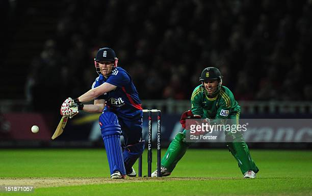 England batsman Eoin Morgan prepares to reverse sweep watched by South Africa wicketkeeper AB de Villiers during the 3rd NatWest International T20...