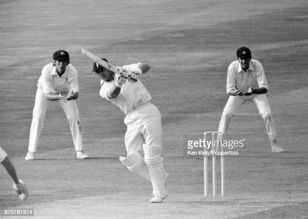England batsman Geoff Boycott drives Greg Chappell of Australia for 4 runs to bring up his 100th century on the first day of the 4th Ashes Test match...