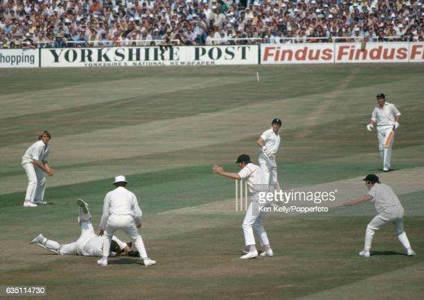 England batsman Geoff Boycott on 22 out of his score of 191 looks back to see Australian wicketkeeper Rod Marsh drop a chance off the bowling of Max...
