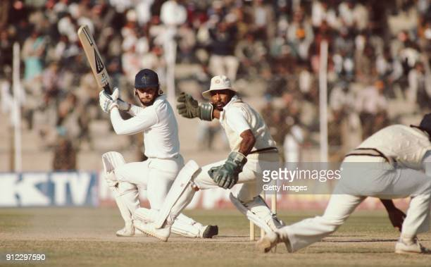 England batsman Graeme Fowler picks up some runs watched by India wicketkeeper Syed Kirmani during the batsman's 201 during the 4th Test Match at...