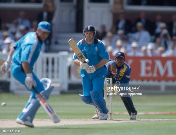 England batsman Graeme Hick hits the ball past teammate Nasser Hussain during his innings of 86 runs in the 2nd Emirates Triangular Series One Day...