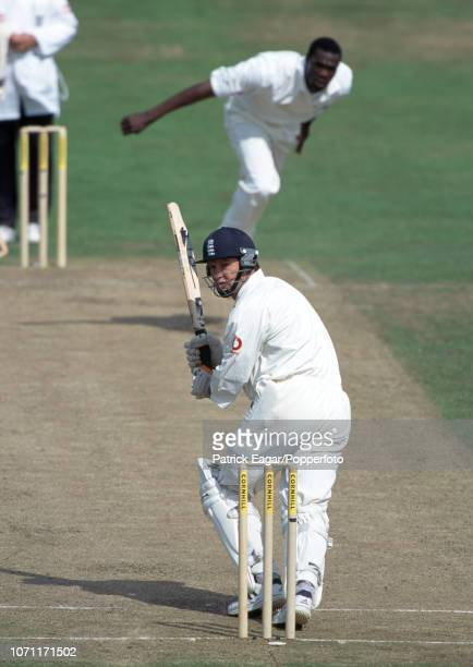 England batsman Graeme Hick plays a delivery from West Indies bowler Reon King during the 4th Test match between England and West Indies at...