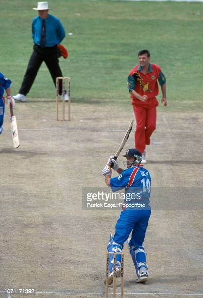 England batsman Graeme Hick plays a shot off a delivery from John Rennie of Zimbabwe during the 2nd One Day International between Zimbabwe and...