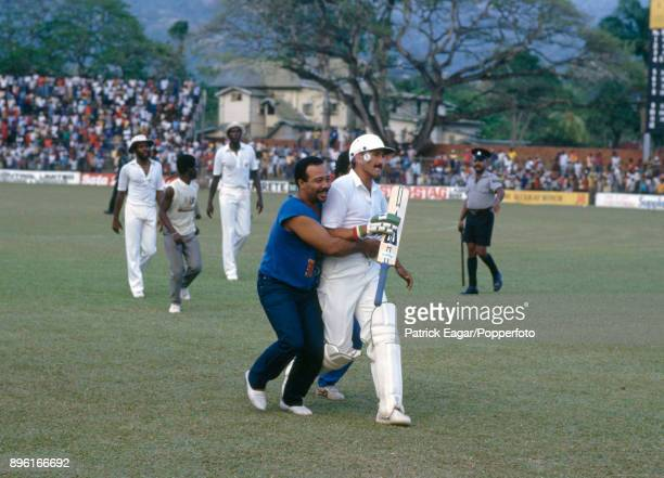 England batsman Graham Gooch is congratulated by spectators on his innings of 129 not out as he walks off the field at the end of the 2nd One Day...
