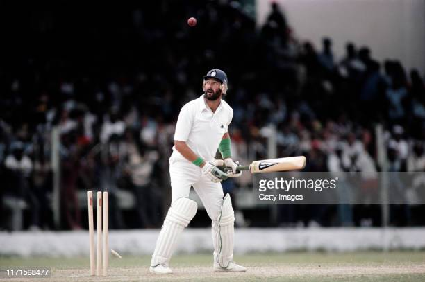 England batsman Graham Gooch reacts after being bowled by Joel Garner for 26 runs during the 3rd Test Match against the West Indies at Bridgetown...